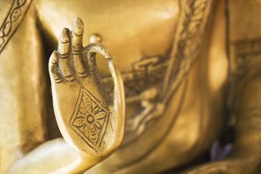 Mano del buddha d'oro