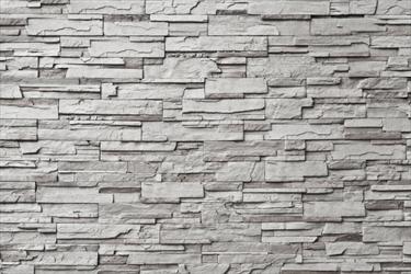 Muro di pietra grigia